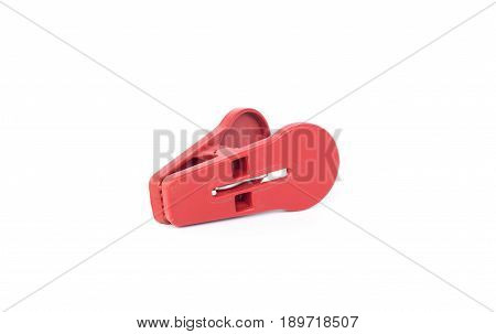 red clothspin or clothes pegs isolated on white