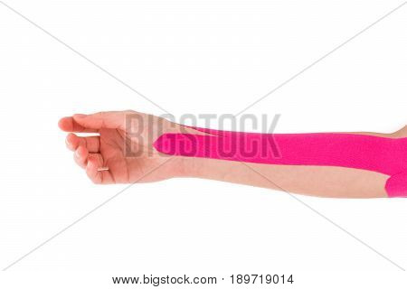 Physiotherapy treatment with kinesiology tape. Therapeutic tape for wrist pain, aches and tension.