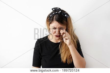 Headshot of sad crying disappointed funny business woman. Portrait of Caucasian stressed frustrated young woman looking unhappy. Negative human emotion facial expression reaction attitude
