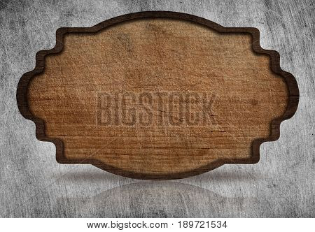 Brown wooden ornate, scratched signboard with dark frame and reflection on grunge metal background