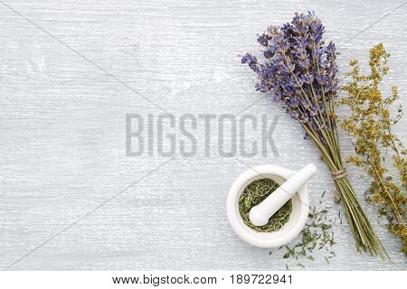 Bunch Of Lavender, Healing Herbs And Mortar On Gray Wooden Table. Herbal Medicine. Top View, Flat La
