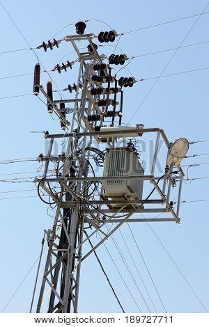 A Turkish electricity pylon against a blue sky