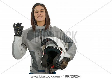Happy young woman showing proudly her new motorcycle license on white