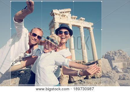 Positive young family take a sammer vacation selfie photo on antique sights view
