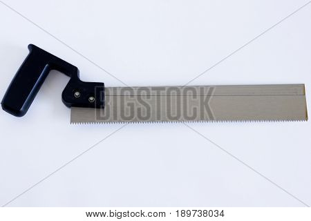 Iron saw on white background. Saw with a black plastic handle on a white background