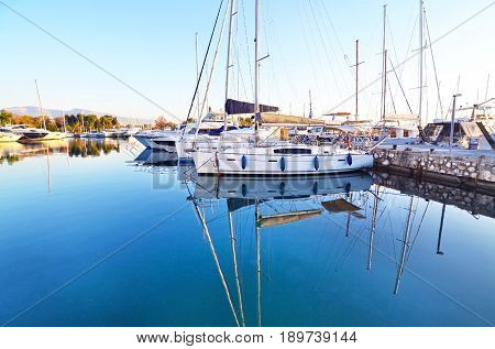 boats reflected on sea Faliro Attica Greece