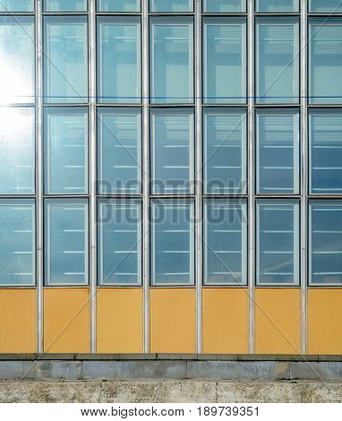 Architecture abstract background. Glass curtain wall texture. Stained-glass system based on outdated technology. Facade detail