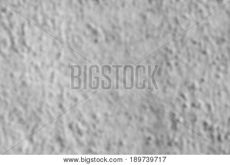 Texture of a rough wall. Blurred background. Rectangular photo.