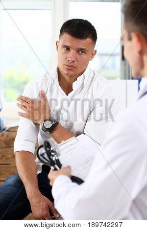 Male Patient Portrait With Doctor Filling Patient History List