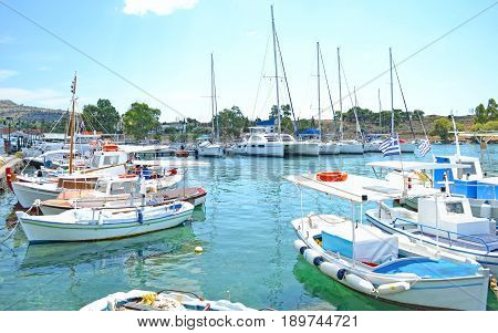 small harbor with boats at Aegina island Saronic Gulf Greece