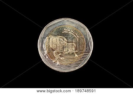 A close up image of a 200 colombian peso coin on a black background