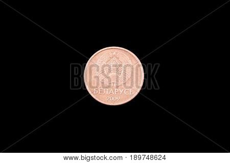 Belorussian one kopeck coin close up on a black background