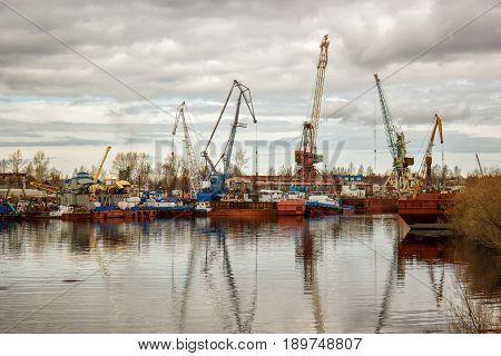 the image ship repair dock, tug river crane