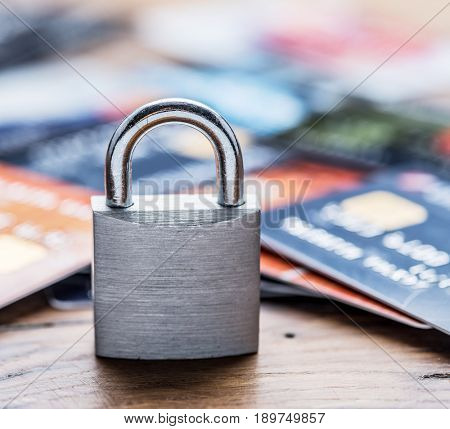 Credit cards and simle mechanical lock. Security concept.