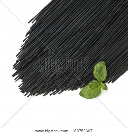 square image of black squid ink spaghetti pasta on a isolated on a white background with green basil