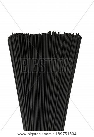 vertical image of black squid ink pasta fanned out on a white isolated background, copy space at top