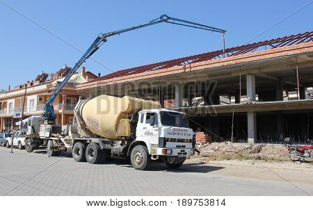 31ST MAY 2017,FETHIYE,TURKEY: Concrete being pumped by workers on a new build in fethiye, turkey, 31st may 2017