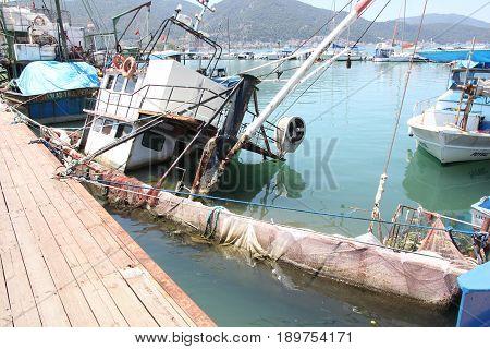 31ST MAY 2017,FETHIYE,TURKEY: A sunken fishing boat along the port of fethiye in turkey ,31st may 2017