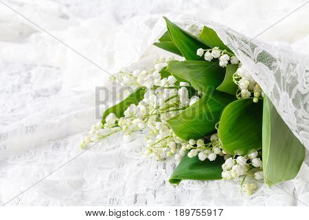 Lilies Of The Valley In A White Porcelain Vase