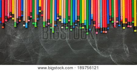 Colored Pencils On A Black Board