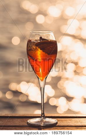 Aperol Spritz At A Wooden Pier At Sunset. Luxury Resort Vacation Concept. Festive Relax Getaway Back