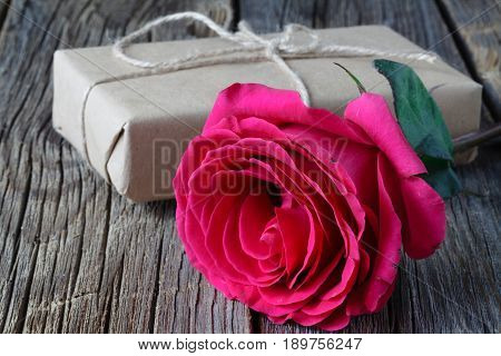 Single Fresh Pink Rose Symbolic Of Love And Romance On A Rustic Wooden Table For A Sweetheart On Val