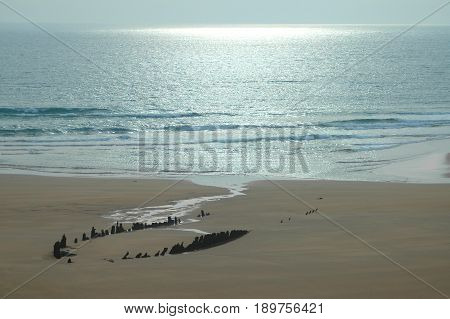 Remains of an ancient shipwrecked boat off the coast in Rattray, Scotland