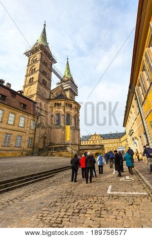 Bamberg, Germany - February 19, 2017: Bamberg city center street view with cathedral and group of people