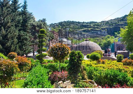 Tbilisi, Georgia - April 24, 2017: Abanotubani, Sulfur Bath in old town of Tbilisi and part of the green park