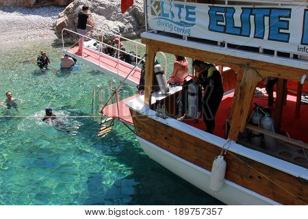 FETHIYE,TURKEY,1ST JUNE 2017: Tourists Scuba diving off the back of a diving boat around the beautiful and scenic bays near Fethiye,turkey 1st june 2017