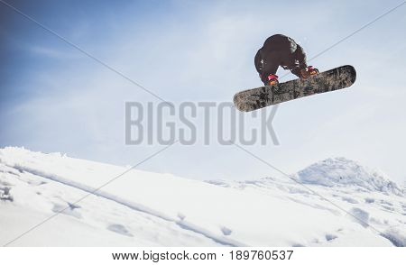 Snowboarder performing tricks on the snow with the board