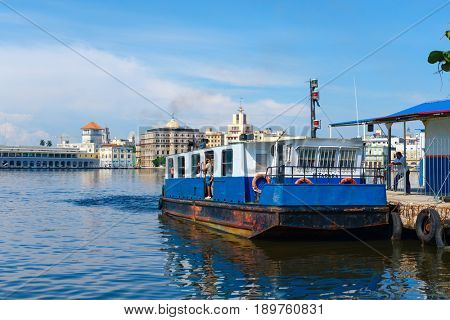 HAVANA,CUBA - JUNE 1, 2017 : A small ferry boat carries passengers across the bay of Havana in Cuba