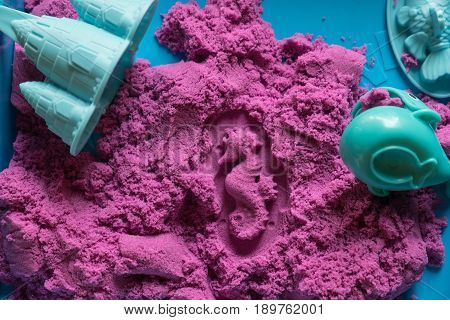Sea horse shape stamped into the colorful kinetic sand