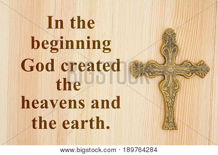 Genesis 1 - The Beginning text with a gold detailed cross on wood