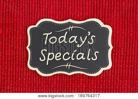 Today's Specials hand lettering text on a chalkboard on a shiny red material