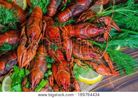 Boiled Tasty River Crayfish On Natural Wooden Background With Fennel (dill) And Lemon On The Side
