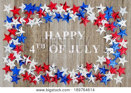 Happy 4th of July text with red white and blue stars on weather wood