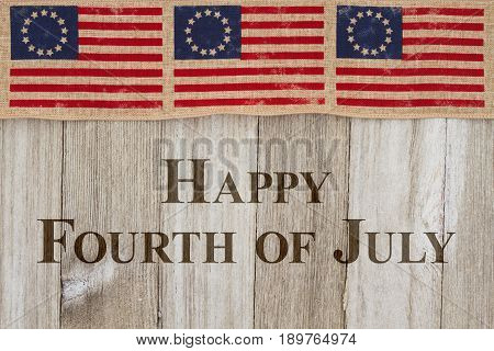Happy Independence Day Greeting USA patriotic old flag on a weathered wood background with text Happy 4th of July Day