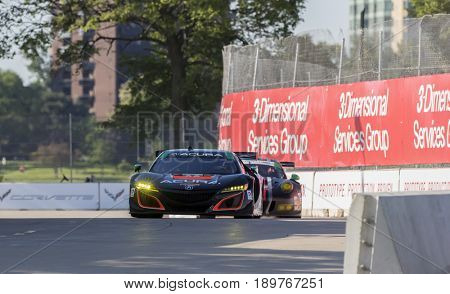 June 02, 2017 - Detroit, Michigan, USA:  The Michael Shank Racing Acura NSX GT3 races through the turns at the Chevrolet Sports Car Classic at Belle Isle Street Course in Detroit, Michigan.