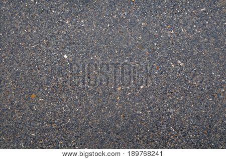 Texture of an old worn asphalt road