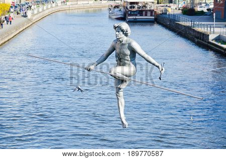 BYDGOSZCZ, POLAND. 8th APRIL 2017. The tightrope-walker sculpture over the River Brda is one of the many cultural attractions that are pulling tourists into the cit of Bydgoszcz in ever greater numbers.