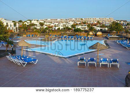 Playa Blanca, Lanzarote, April 03, 2017: Swimming Pool And Buildings In The Hotel In Playa Blanca, L