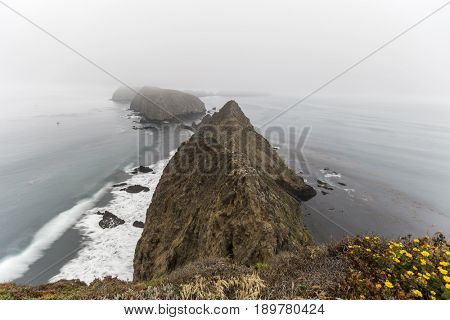 Foggy view from Anacapa Island cliff at Channel Islands National Park near Ventura, California.