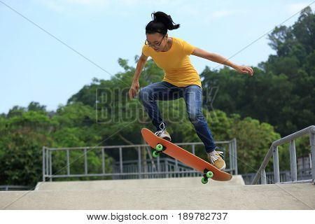 closeup of skateboarder skateboarding at skate park