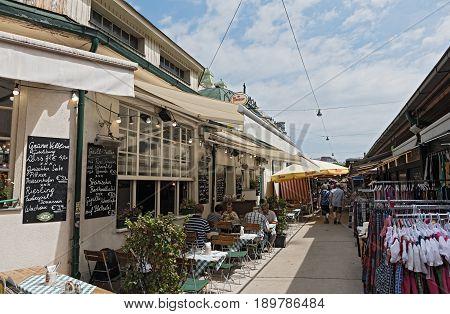 VIENNA, AUSTRIA-JUNE 01, 2017: People enjoy the Naschmarkt in Vienna, Austria