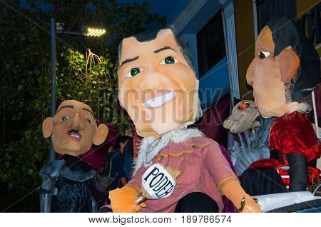Quito, Ecuador - December 31, 2016: Traditional monigotes or stuffed dummies representing political figures, anime or famous cartoons, with a short description that will get burned to celebrate new year in Ecuador.