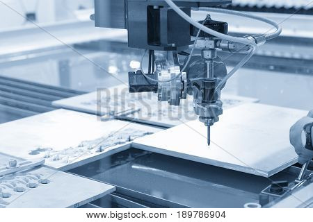 The water jet machine cutting the metal plate .The hi-precision machining concept.