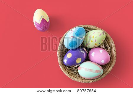 A variety easter painted eggs is in bucket.