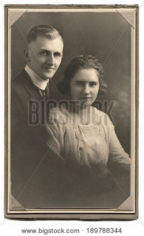 UNITED STATES - CIRCA 1925: Paper framed portrait of a young married couple