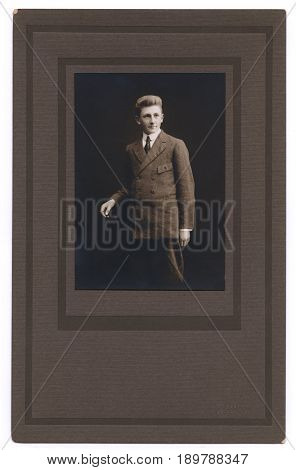 UNITED STATES - CIRCA 1915: Paper framed portrait of a teenage boy wearing a suit and tie